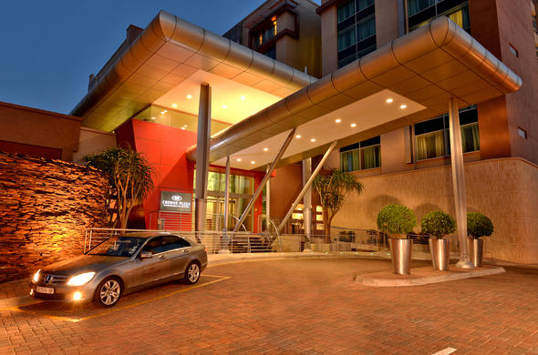 Exterior view of Crowne Plaza Johannesburg by night.