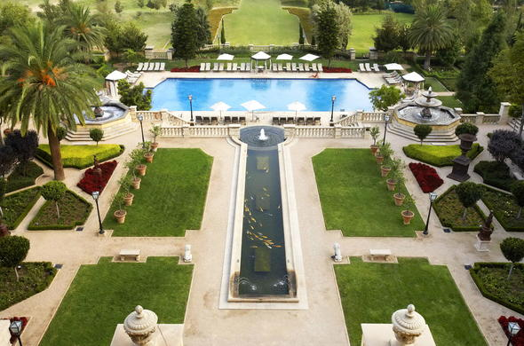 Breathtaking view of the garden and pool area at Palazzo Montecasino.