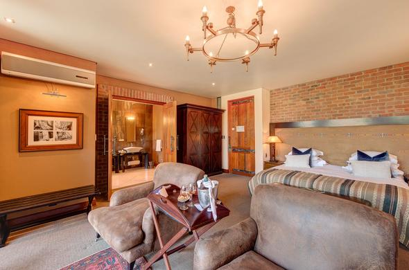 Luxurious suite with en-suite bathroom at Tintswalo at Waterfall.
